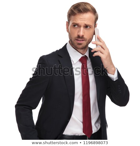 anxious businessman talking on the phone looks to side Stock photo © feedough