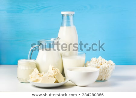 Stock photo: Fresh dairy products on white table background. Glass jar of milk, bowl of sour cream, cottage chees