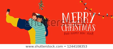 Christmas banner of couple selfie under mistletoe Stock photo © cienpies