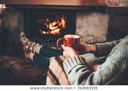 Woman sitting by fireplace Stock photo © Lana_M