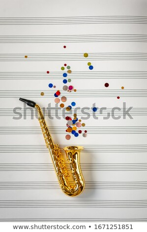 Golden saxophone with music notes Stock photo © colematt