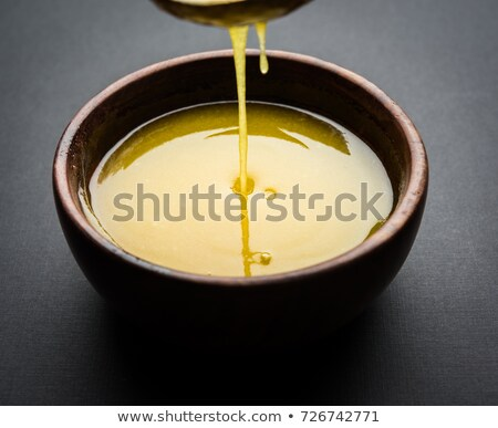Spoonful of ghee melted butter Stock photo © maxsol7