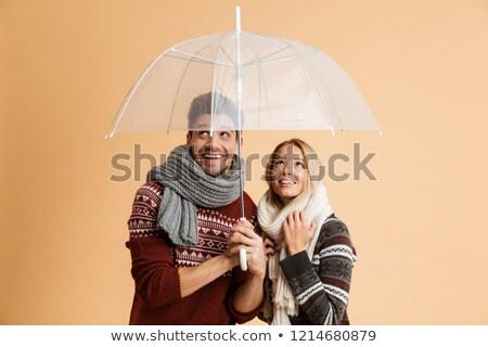 Emotionat tineri iubitor cuplu izolat bej Imagine de stoc © deandrobot
