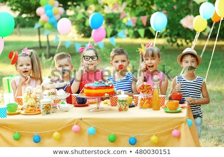 happy girls on birthday party at summer garden Stock photo © dolgachov