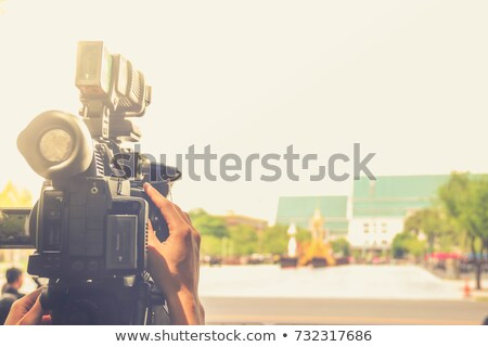 News reporter and professional cameraman Stock photo © colematt