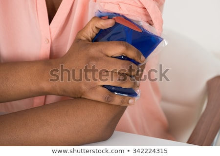 Woman Using Ice Gel Pack On Arm Stock photo © AndreyPopov