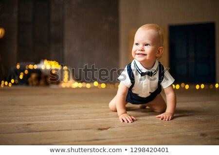 улыбаясь ребенка мальчика гирлянда полу Сток-фото © Stasia04