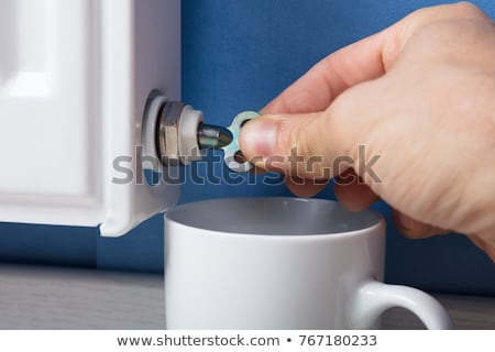 Person's Hand Turning Radiator Bleed Valve To Release Air Stock photo © AndreyPopov