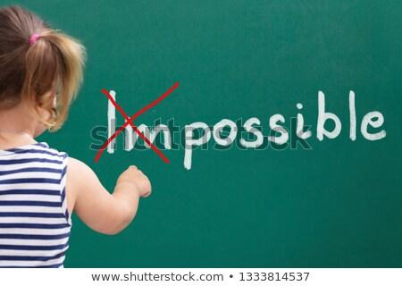 Menina atravessar impossível palavra quadro-negro Foto stock © AndreyPopov