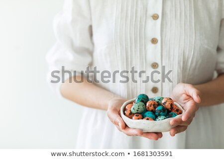 Stock photo: Boiled chicken eggs on a blue ceramic plate. The concept of Easter Holidays