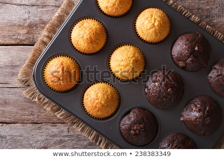 close up of frosted cupcakes or muffins on tray Stock photo © dolgachov