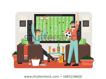 friends or football fans with soccer ball on sofa stock photo © dolgachov