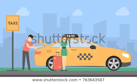 Taxi driver putting luggage of women in trunk of car Foto stock © Kzenon