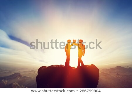 Agreement with Partners, Businessman on Peak Top Photo stock © robuart
