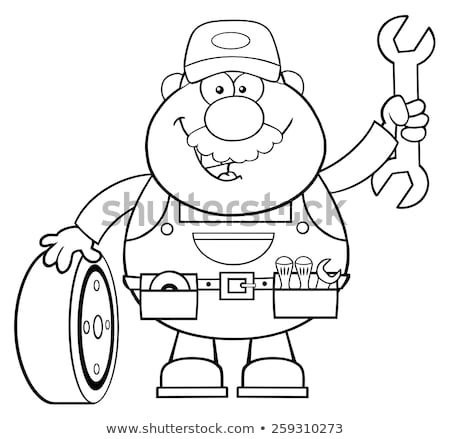black and white smiling mechanic cartoon character with tire and huge wrench stock photo © hittoon