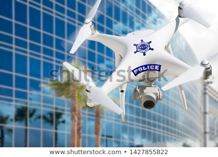 Politie vliegtuigen vliegen boven stad straat Stockfoto © feverpitch