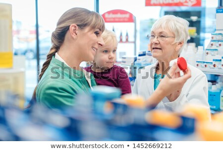 Friendly pharmacist, mother and child having fun in pharmacy Stock photo © Kzenon
