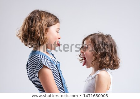 Naughty little sisters sticking out their tongues Stock photo © Giulio_Fornasar