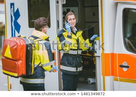 Медик · говорить · радио · скорой · человека · женщину - Сток-фото © kzenon