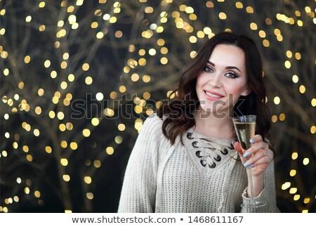 Uśmiechnięta kobieta sweter szkła szampana światła strony Zdjęcia stock © dashapetrenko