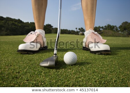 Close up of woman about to make a putt. Stock photo © lichtmeister
