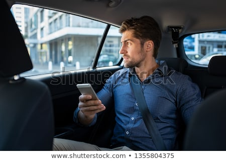 Pensive businessman with smartphone thinking of where to go for lunch Stock photo © pressmaster