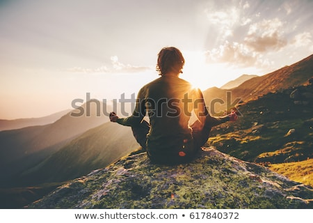 Man Meditating in Mountains, Traveling and Tourism Stock photo © robuart