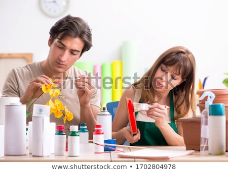 Couple decorating pots in workshop during class Stock photo © Elnur