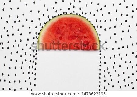 Watermelon seeds raining on melon slice protecting the area bene Stock photo © lightkeeper