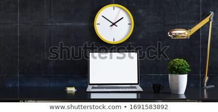 laptop on desk with plant, desk lamp, watch and black concrete w Stock photo © sedatseven