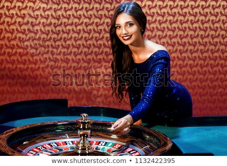 幸せな女の子 ルーレット盤 受賞 若い女の子 黄色 シャツ ストックフォト © robuart