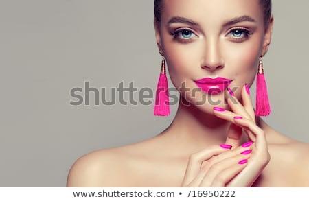 Güzel bir kadın pembe makyaj yüz Stok fotoğraf © lubavnel