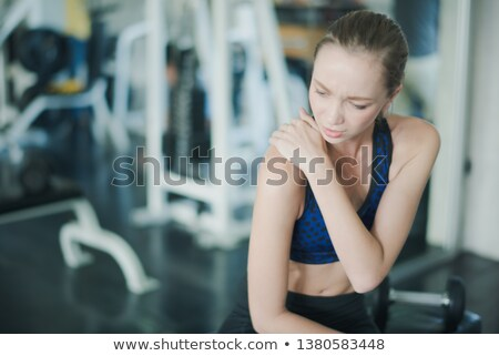young caucasian bodybuilder having a shoulder pain stock photo © dacasdo