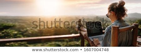 женщину ноутбука морем используя ноутбук влажный Сток-фото © smithore