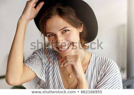 closeup portrait of young woman in hat stock photo © hasloo