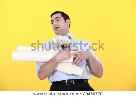 Man struggling to carry wallpaper Stock photo © photography33