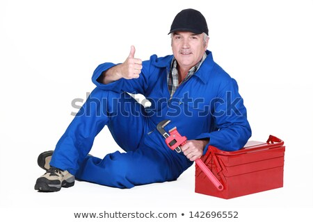 Approving tradesman posing with his tools Stock photo © photography33