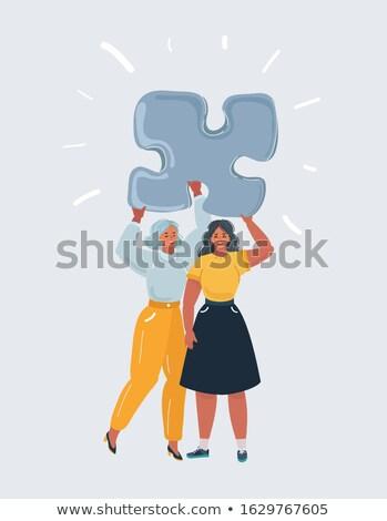 Playful woman holding a jigsaw Stock photo © photography33