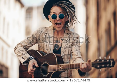 The guitarist on beige Stock photo © sifis
