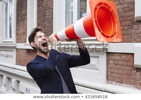 Man shouting into traffic cone Stock photo © photography33