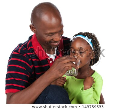 Man with little girl drinking glass of water Stock photo © photography33