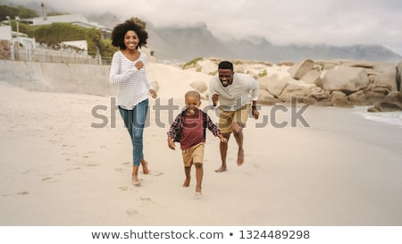 Man at the beach with his family Stock photo © photography33