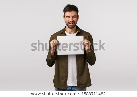man showing a piece of paper Stock photo © photography33