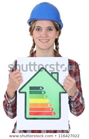 tradeswoman holding up an energy efficiency rating chart and a wad of money stock photo © photography33