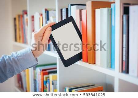 Stack of colorful books with e-book reader Stock photo © AndreyKr