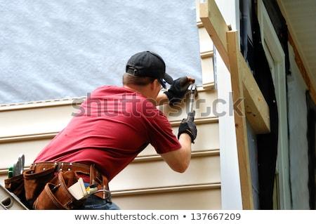 Holding siding Stock photo © elxeneize