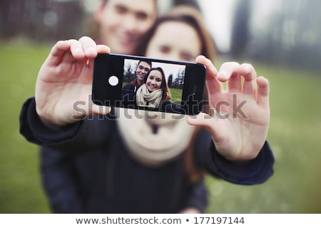 two couples of young people taking their picture with phone stock photo © feedough