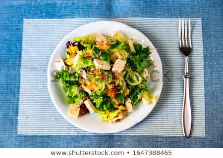 Fresh rucola  salad on fork isolated on white background cutout. Stock photo © natika