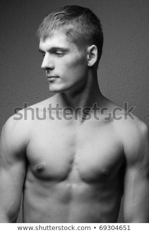 小さな 男 筋骨たくましい体 若い男 手 顔 ストックフォト © konradbak