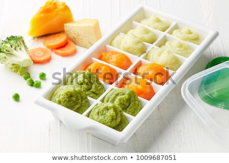 Broccoli in ice cube Stock photo © Givaga